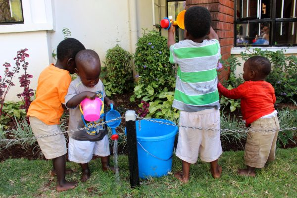 Toddlers watering